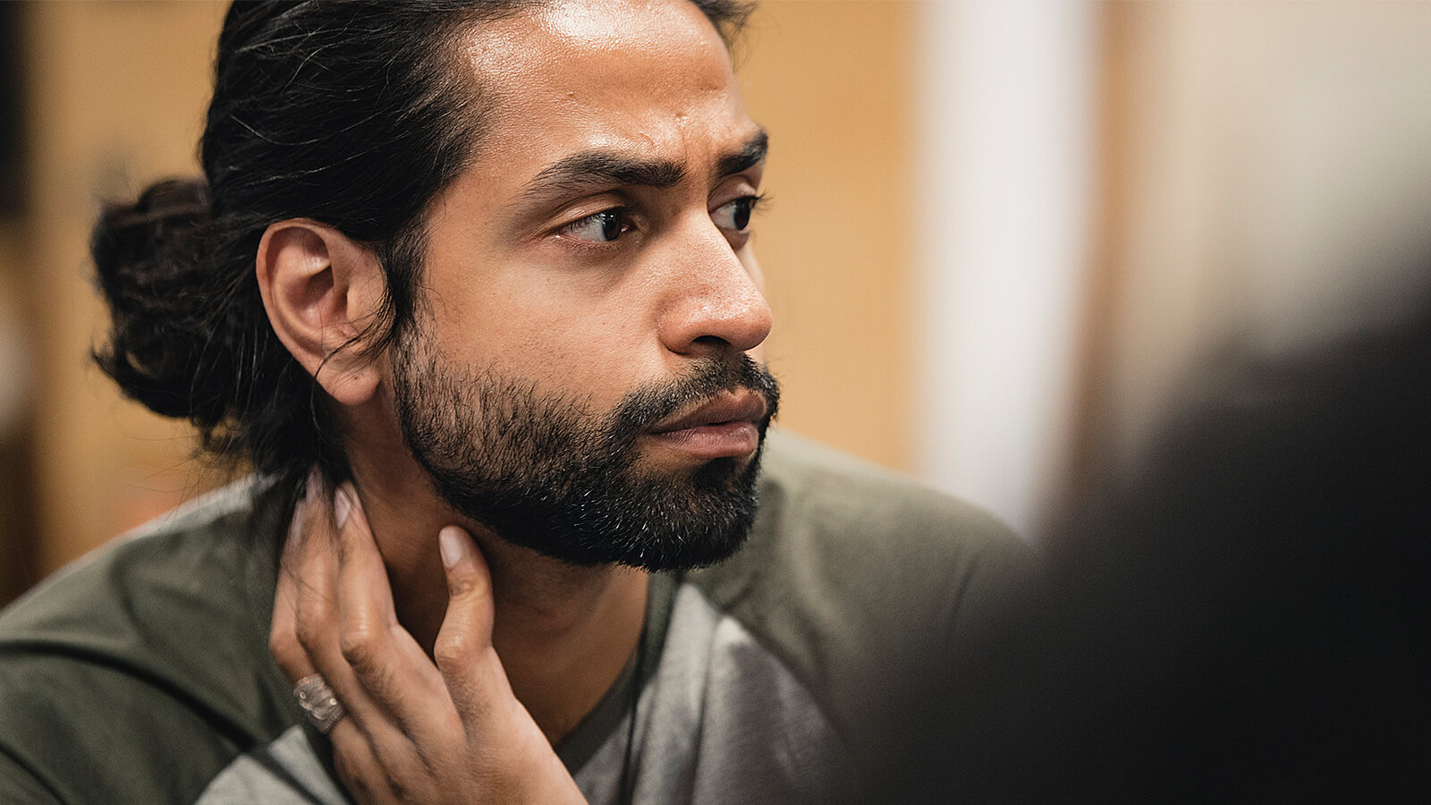 A man listening closely to therapist in support group